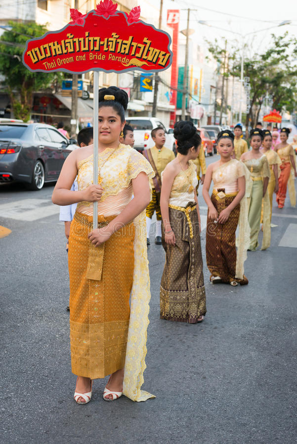 Old Phuket town festival. PHUKET, THAILAND - 07 FEB 2014: Phuket town residents take part in procession bride parade of annual old Phuket town festival royalty free stock image