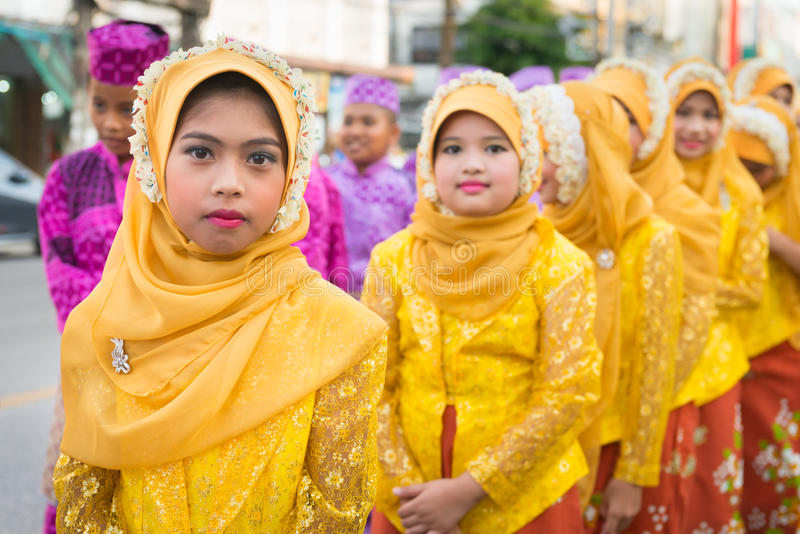 Old Phuket town festival. PHUKET, THAILAND - 07 FEB 2014: Children in muslim headscarf take part in procession parade of annual old Phuket town festival royalty free stock image