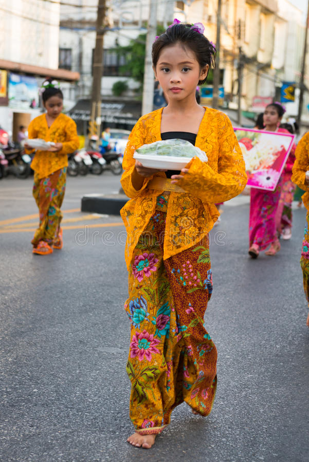 Old Phuket town festival. PHUKET, THAILAND - 07 FEB 2014: Young girl in traditional dress takes part in procession parade of annual old Phuket town festival royalty free stock images