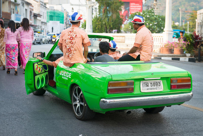 Old Phuket town festival. PHUKET, THAILAND - 07 FEB 2014: Phuket town residents on green car take part in procession of annual old Phuket town festival stock photography