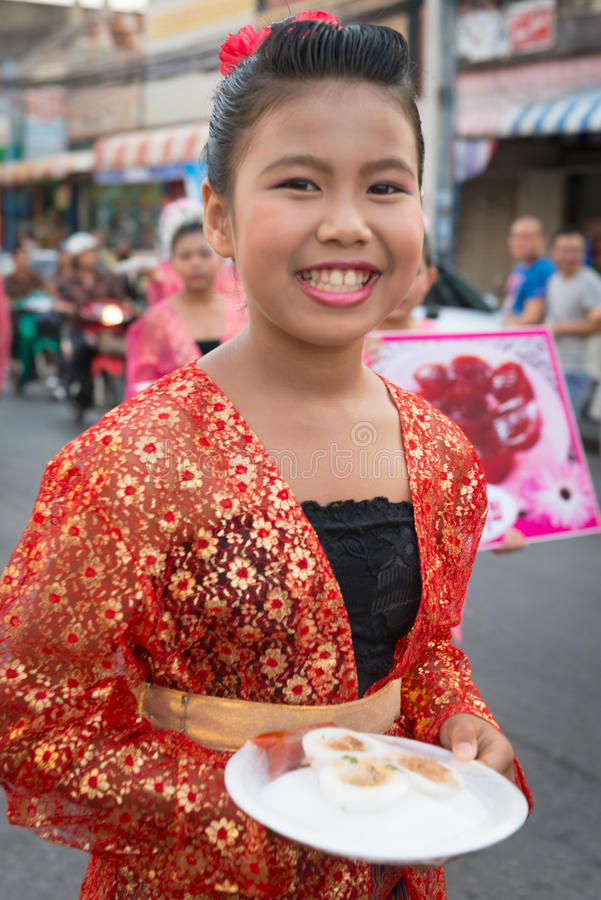 Old Phuket town festival. PHUKET, THAILAND - 07 FEB 2014: Happy girl take part in procession parade of annual old Phuket town festival royalty free stock images