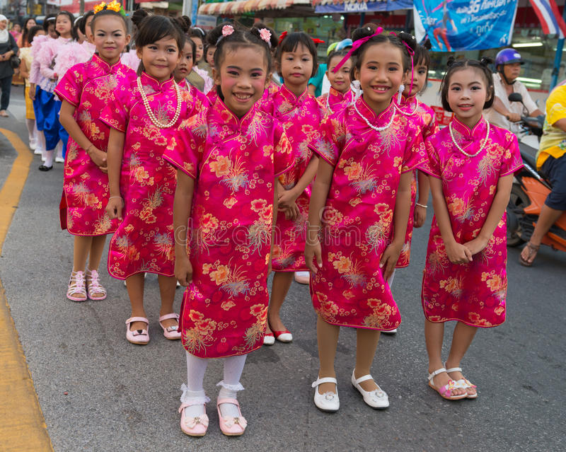 Old Phuket town festival. PHUKET, THAILAND - 07 FEB 2014: Children in red traditional dress take part in procession parade of annual old Phuket town festival royalty free stock photos