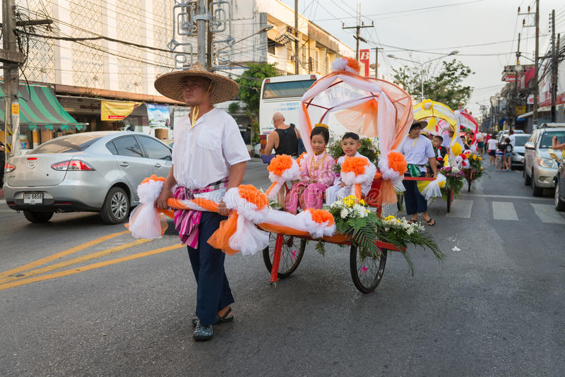 Old Phuket town festival. PHUKET, THAILAND - 07 FEB 2014: Rickshas with passenger take part in procession parade of annual old Phuket town festival stock photography
