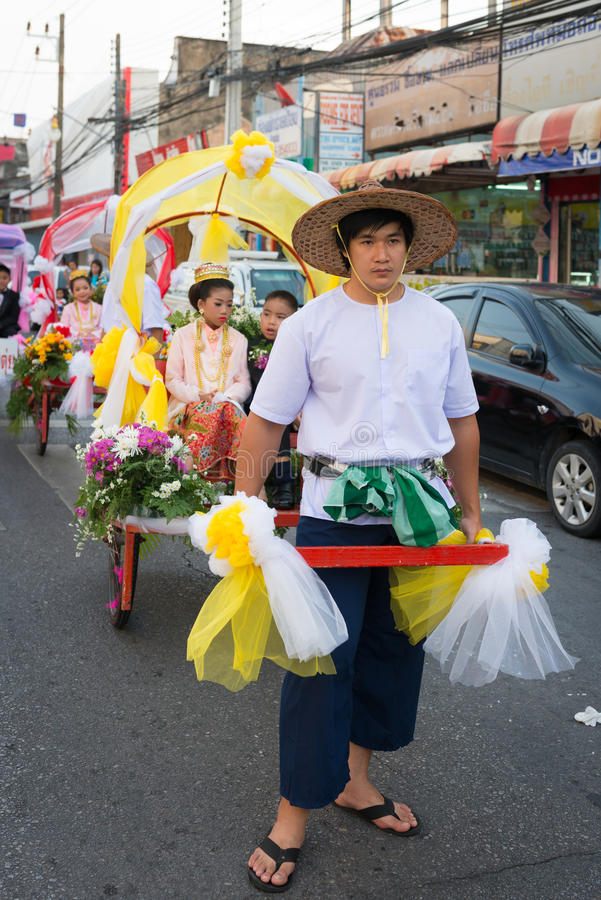 Old Phuket town festival. PHUKET, THAILAND - 07 FEB 2014: Rickshas with passenger take part in procession parade of annual old Phuket town festival royalty free stock image