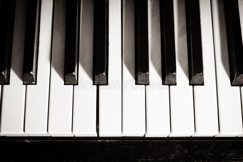 Old piano keyboard. Close up as a music background. Black and white image stock photos