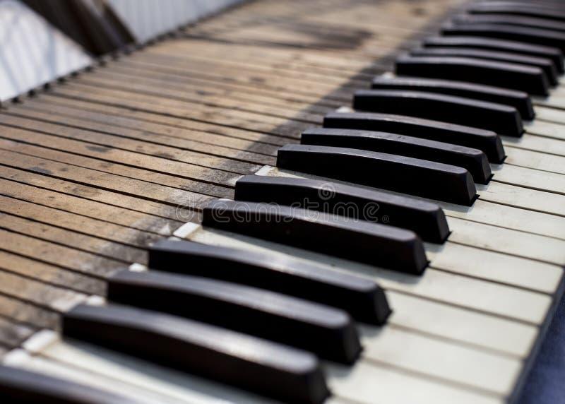 Old piano keyboard. Weathered, old piano keyboard. closeup royalty free stock image