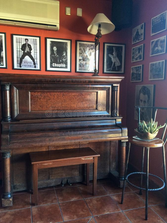 Old piano and photographs of famous singers and actors royalty free stock image
