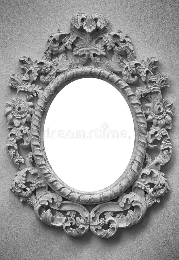 Old picture frame hanging on a wall. For background royalty free stock photos