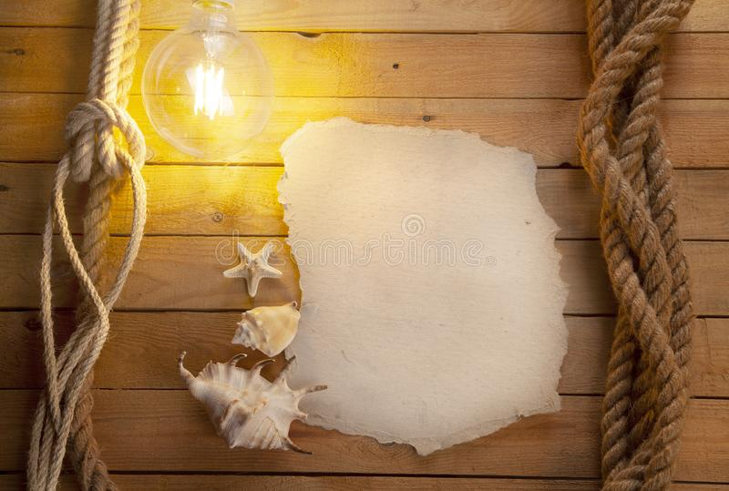 Old sheet of paper on a wooden background. Space for text. stock photo