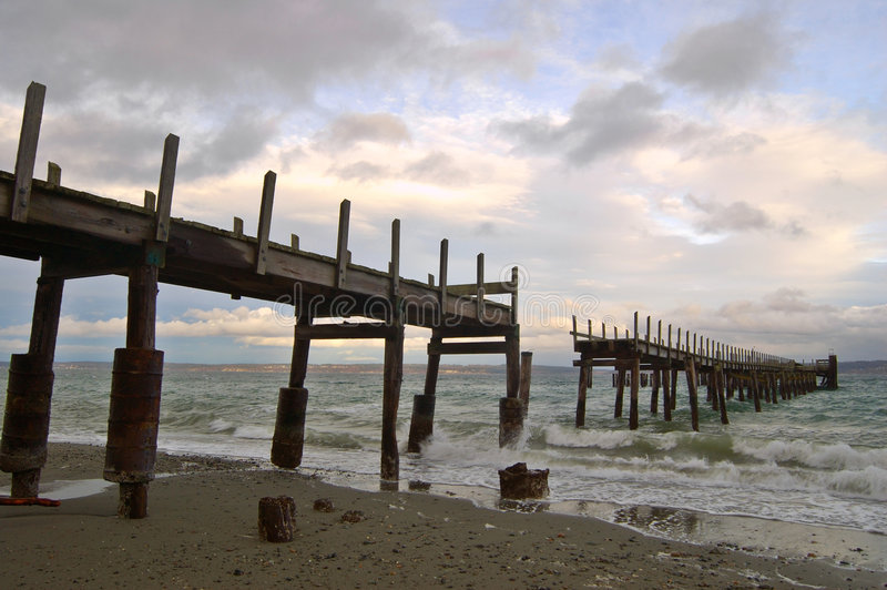 Old pier. An old pier on a stormy afternoon stock images