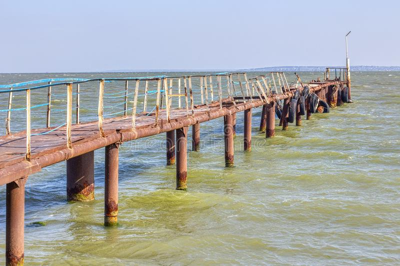 Old pier. With rusty pillars royalty free stock images