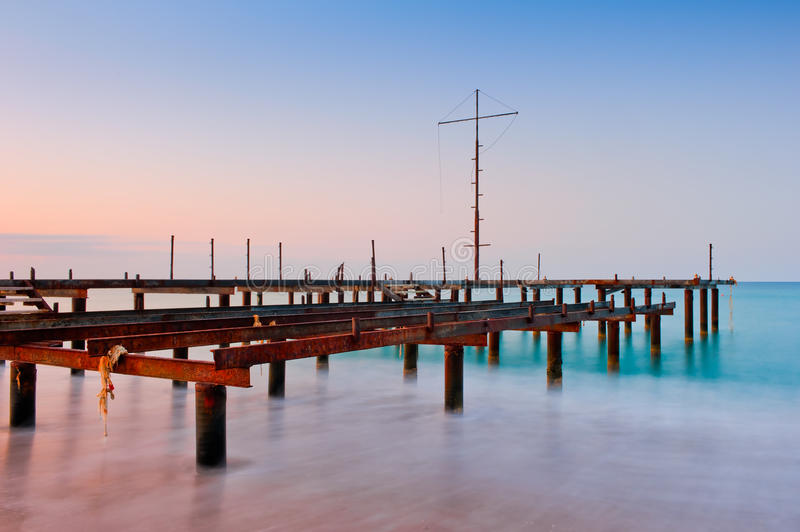 Old pier in the sea stock photos