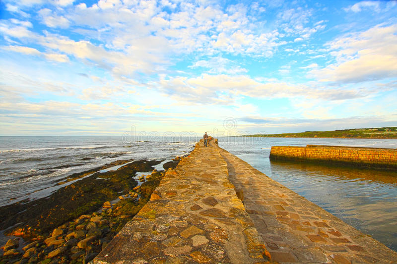Old Pier in St Andrews. Lonely man on the Old Pier in St Andrews, Scotland stock photos