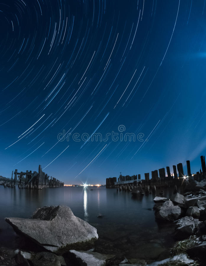 Old pier star trails royalty free stock photography
