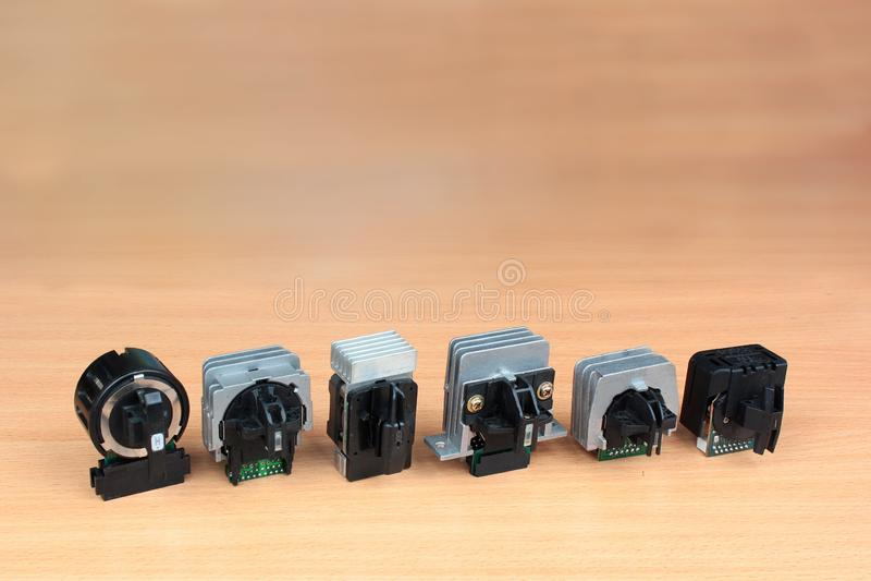 Old 9-pin and 24-pin dot matrix printer printheads.  stock photo