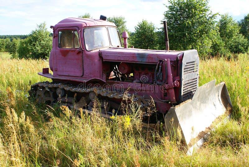Old pink bulldozer. On grass royalty free stock photos
