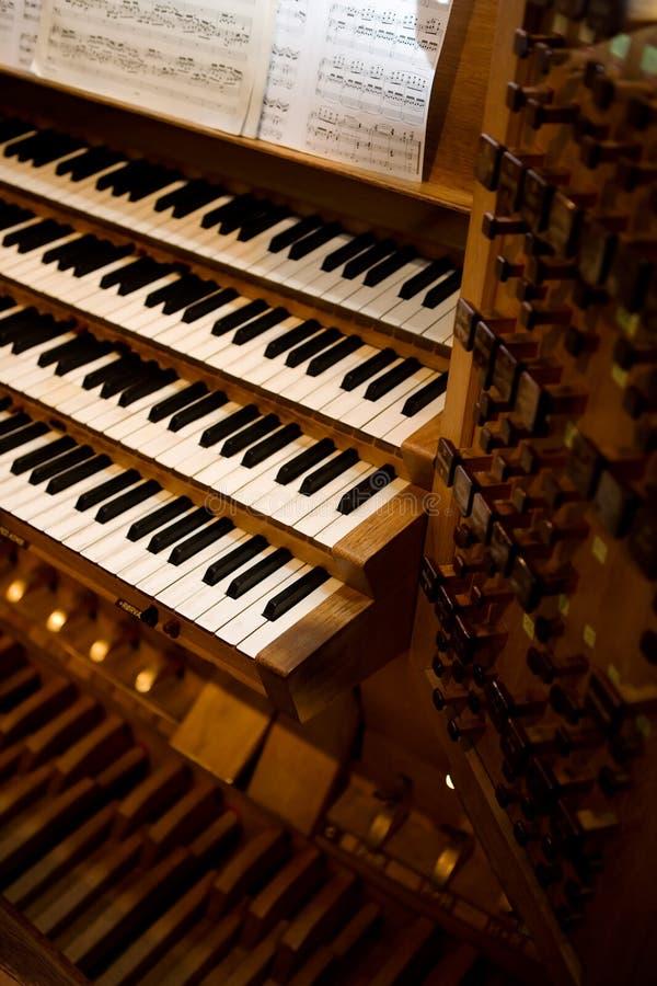 Old Pipe Organ. An old pipe organ keyboard in a church royalty free stock photos