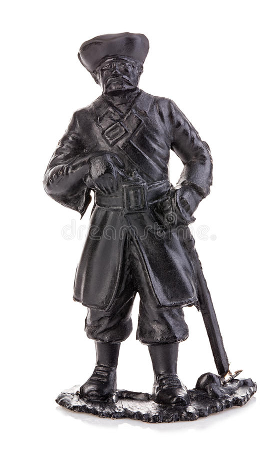 Old pirate captain in authentic looking costume close-up isolated on a white background. Miniature figurine of a children's toy. Old pirate captain in authentic stock images