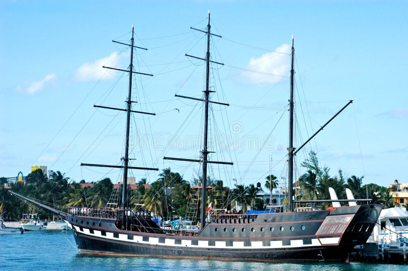Old pirate ship. Resting in the shore stock photo