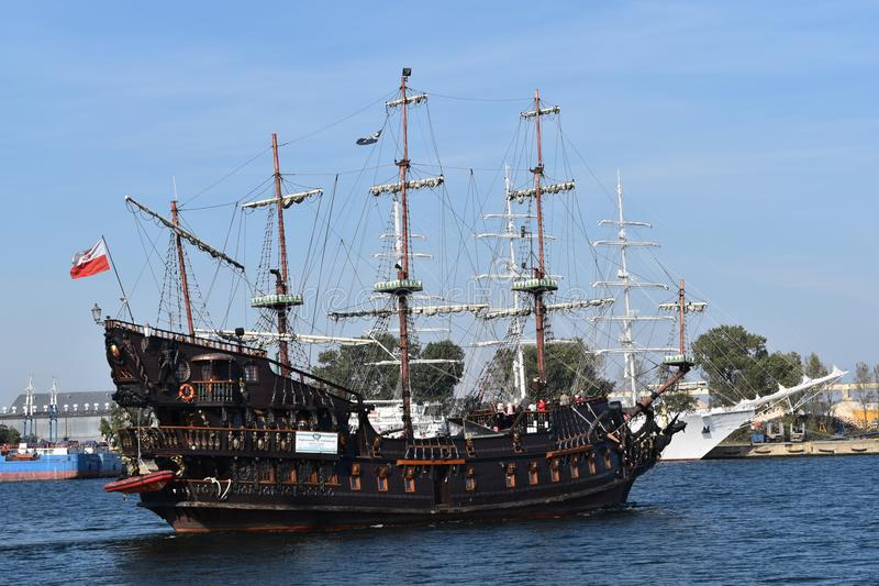 An old pirate ship sailing near sea-front in Gdynia. SAILING VESSEL - Replica of an old pirate ship sailing near sea-front in Gdynia stock photos