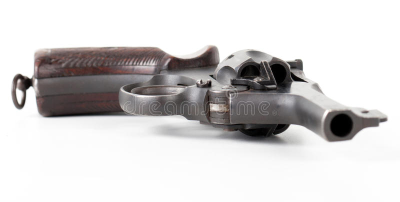 Old pistol. Old black pistol close-up isolated on white background royalty free stock photo