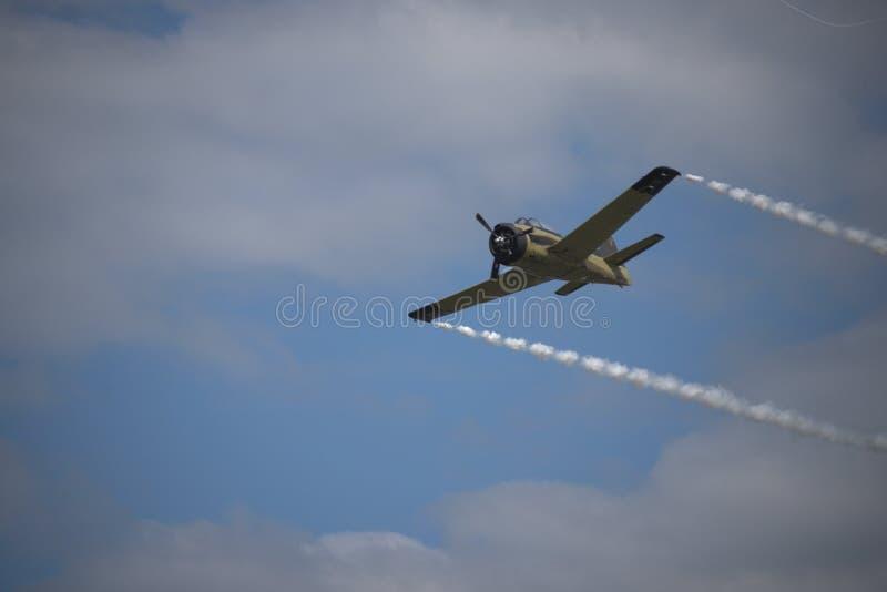 Old plane flying stock photo