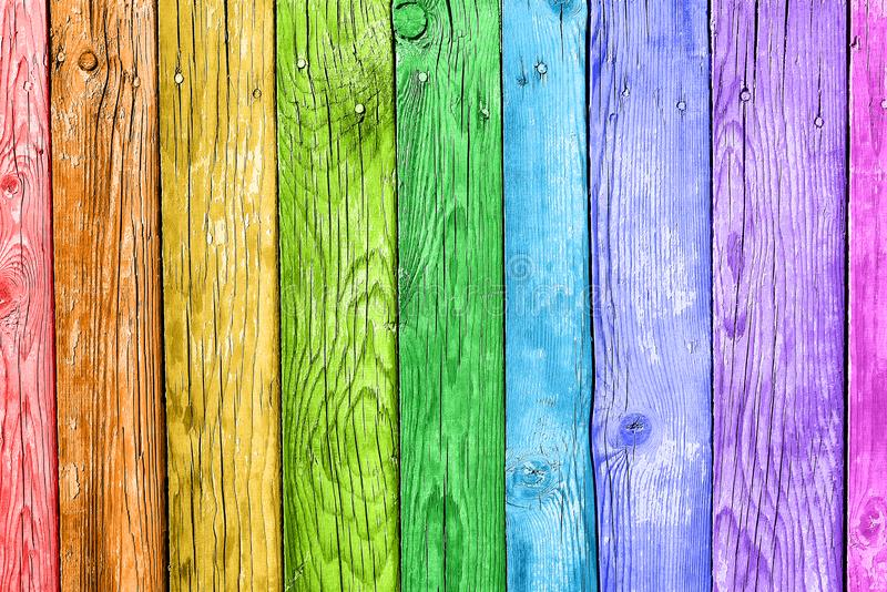 Old planks in the colors of the rainbow. Colorful wood background royalty free stock photo