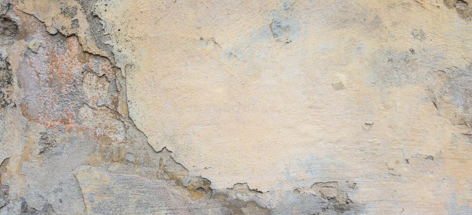 Old Plaster Wall With Peel Grey Stucco Texture Background. Decayed Cracked Rough Abstract Banner Surface. Old Plaster Wall With Peel Grey Stucco Texture royalty free stock photos