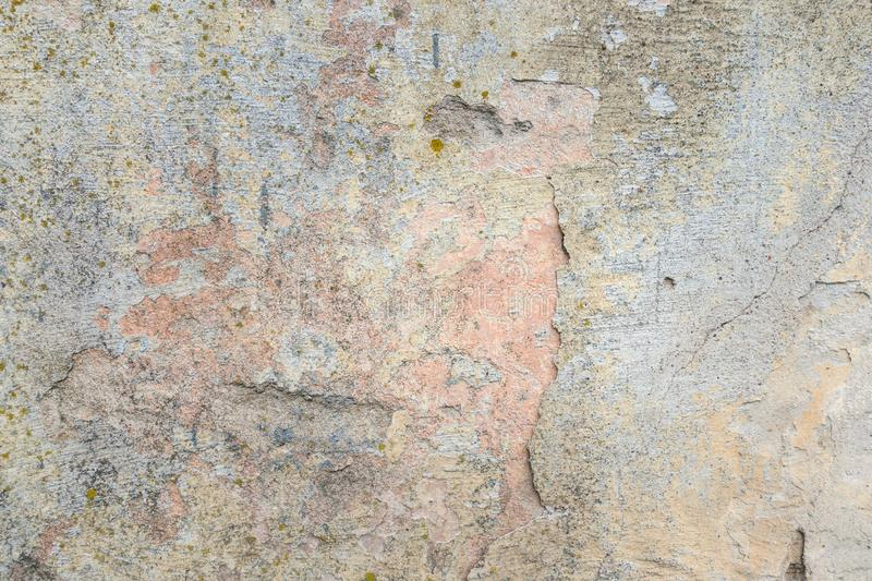 Old Plaster Wall With Peel Grey Stucco Texture Background. Decayed Cracked Rough Abstract Banner Surface. Old Plaster Wall With Peel Grey Stucco Texture stock image