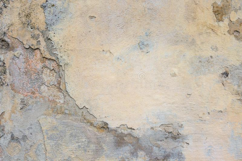 Old Plaster Wall With Peel Grey Stucco Texture Background. Decayed Cracked Rough Abstract Banner Surface. Old Plaster Wall With Peel Grey Stucco Texture stock photography