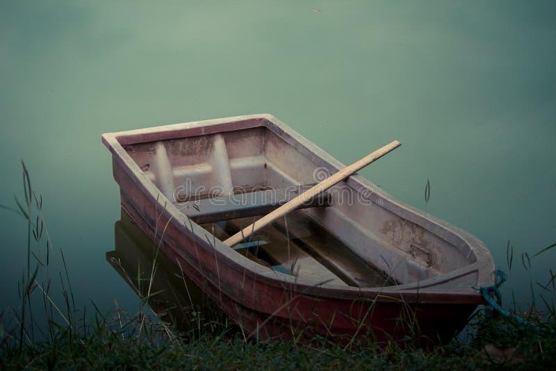 Old plastic boat. stock image