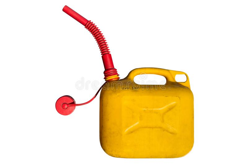 Old plastic five-liter fuel tank in yellow color for transporting and storing petrol with a funnel for fuel. Isolated  on a white stock images