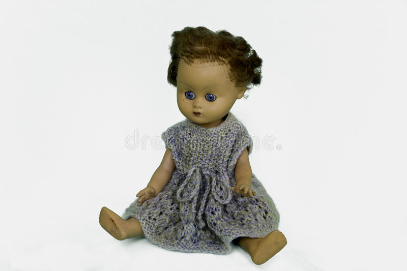 Old play doll with short hair hands down stock photography