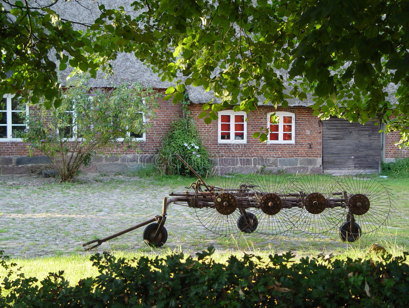 Download Old plow stock image. Image of copple, window, bricks, bush - 15651