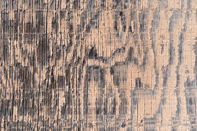 Old plywood with faded beige paint stock photos