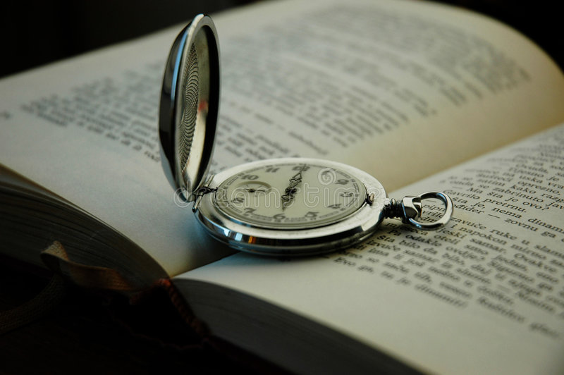 Old pocket watch and book. Photo old pocket watch on the book stock images