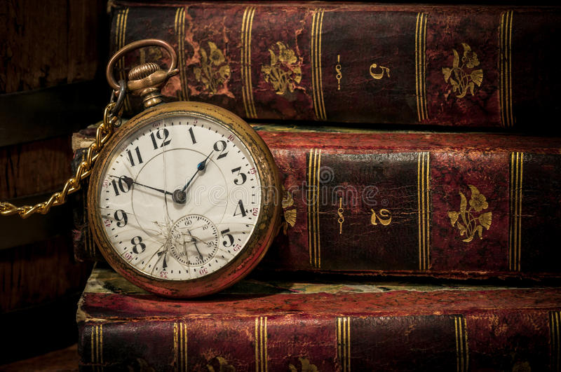 Old pocket watch and books in Low-key copy space royalty free stock photo