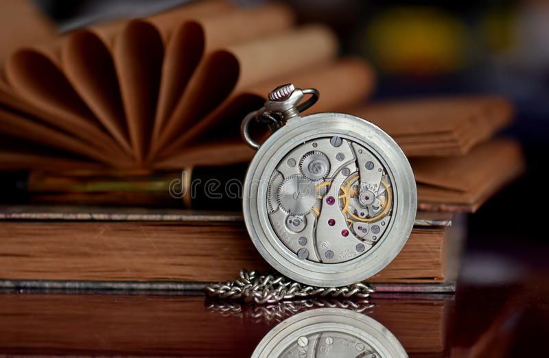 Old pocket watch and books royalty free stock photography