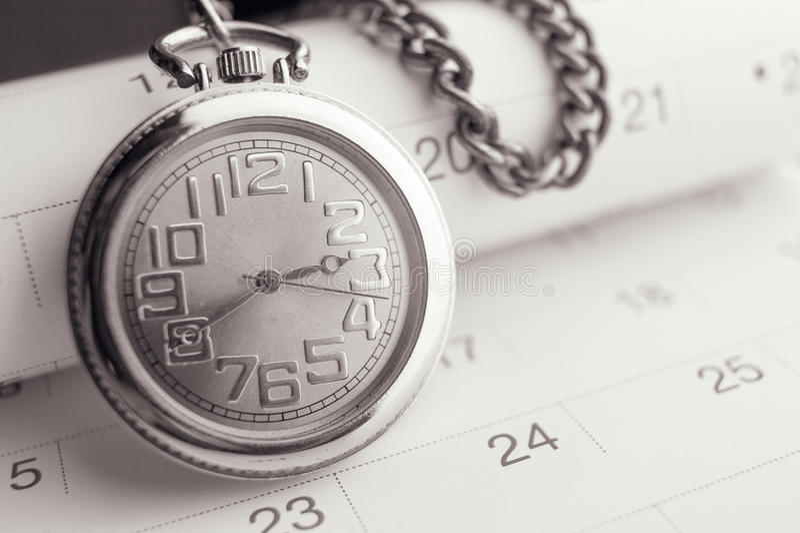 Old pocket watch on calendar page. vintage, black&white stock images