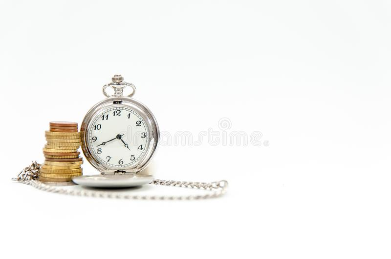 Old pocket watch , coin tower, time is money . Old pocket watch , coin tower, time is money conceptual image isolated on white stock photo