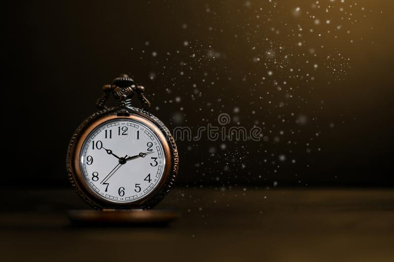 Old pocket watch on dark background. Watches, pockets, clocks, antiques, backgrounds, darks, olds, ageds, vintages, concepts, classics, retros, times, hours royalty free stock photo