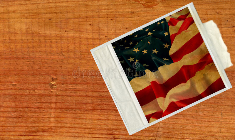 Old polaroid card with vintage flag USA. In wood background stock photo