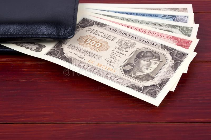 Old Polish money in the black wallet. Old Polish money - Zloty in the black wallet stock photo