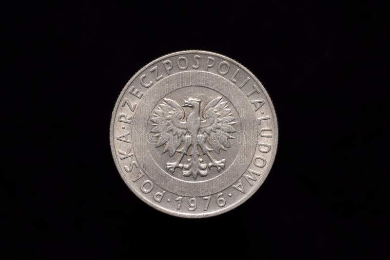 Old Polish 20 zloty coin from 1976, obverse. Polish People`s Republic, Polska Rzeczpospolita Ludowa old 20 zloty, 20zl coin from 1976, obverse showing the coat stock photos