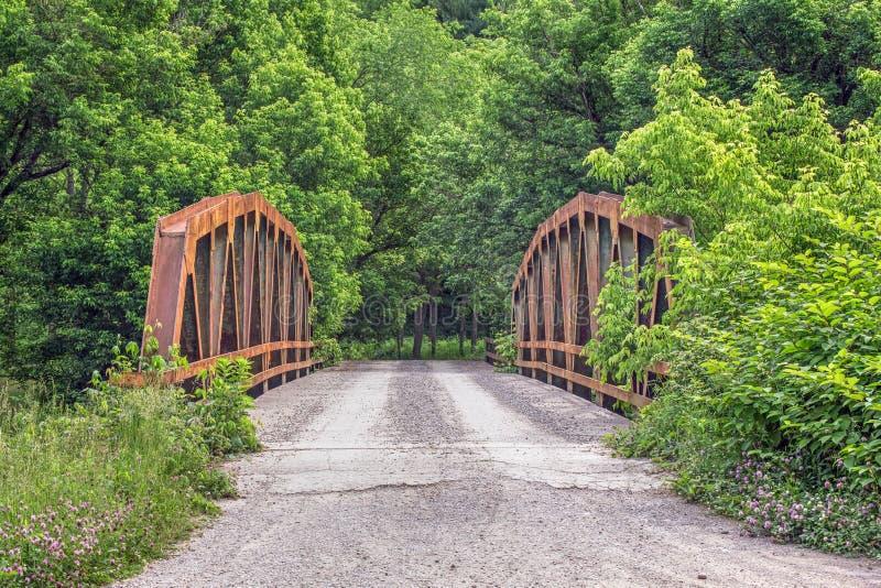 Old Pony Truss Bridge. A rusty old pony truss bridge crosses the Little Muskingum River in rural Monroe County, Ohio stock image