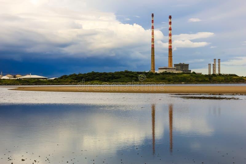 Poolbeg power plant chimneys. Dublin. Ireland. Old Poolbeg power plant chimneys viewed from Sandymount. Dublin. Ireland royalty free stock images