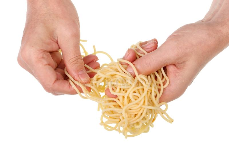 Old poor man eat with hands  long spaghetti pasta with fatty butter isolated macro royalty free stock image