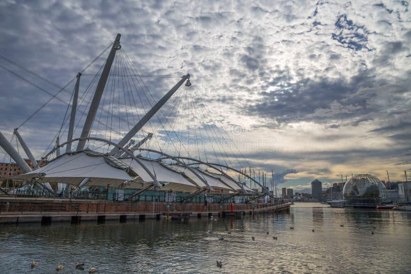 Old port area, `Porto Antico`, touristic place in Genoa, Italy. Old port area, `Porto Antico`, touristic place in Genoa, Italy under a cloudy sky stock images