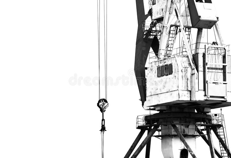 Old port crane and runner on the trails. Contrasting black-and-white photo with free space stock photos