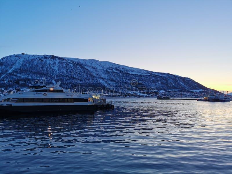 Old port sailing boat at Tromso Norway royalty free stock image